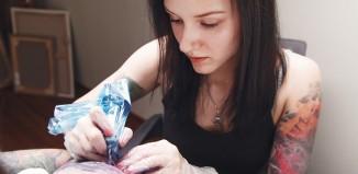 Girl tattoo artist works